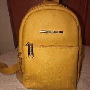 f0b6567f028 Steve Madden Bags - Steve Madden Mustard Yellow Bailey Mini Backpack